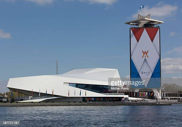 The Eye film Museum beside a decorated building in preparation of the upcoming coronation of Crown Prince Willem Alexander of The Netherlands on...