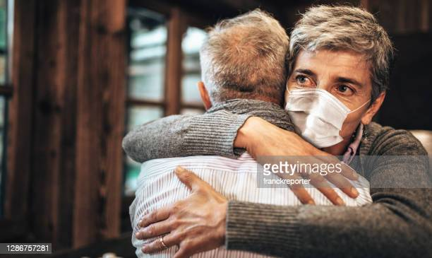 the eye of coronavirus - emotional support stock pictures, royalty-free photos & images