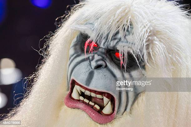 The eyes of an attendee dressed as a Yeti are illuminated after winning a costume contest during the D23 Expo 2015 in Anaheim California US on Friday...