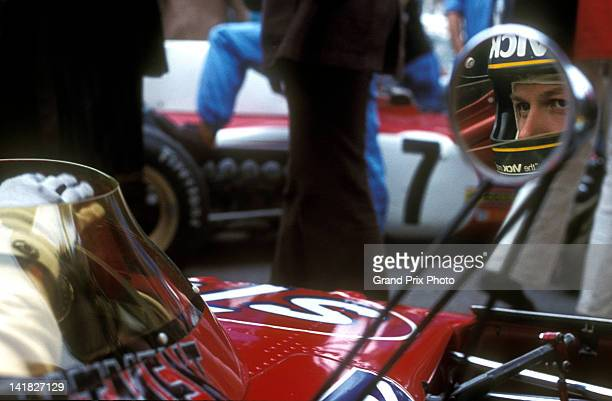 The eyes of Ronnie Peterson of Sweden are reflected in the mirror of the STP March Racing Team March 721X Ford Cosworth DFV V8 before the start of...