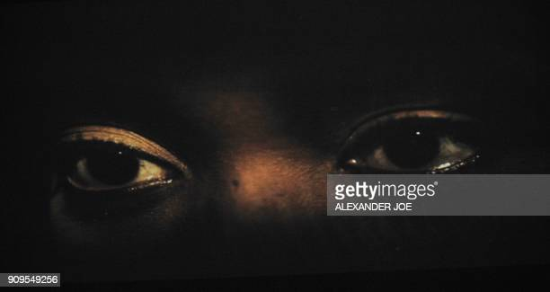 The eyes of Winnie MadikizelaMandela are seen on a screen at the beginning of a rehearsal for 'Winnie the Opera' in Pretoria on April 26 2011 ahead...
