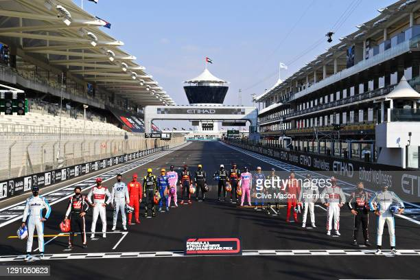 The F1 drivers pose for the Class of 2020 photo on the grid prior to the F1 Grand Prix of Abu Dhabi at Yas Marina Circuit on December 13, 2020 in Abu...