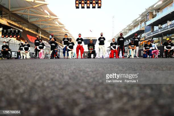 The F1 drivers stand and take a knee in support of the movement to end racism prior to the F1 Grand Prix of Abu Dhabi at Yas Marina Circuit on...