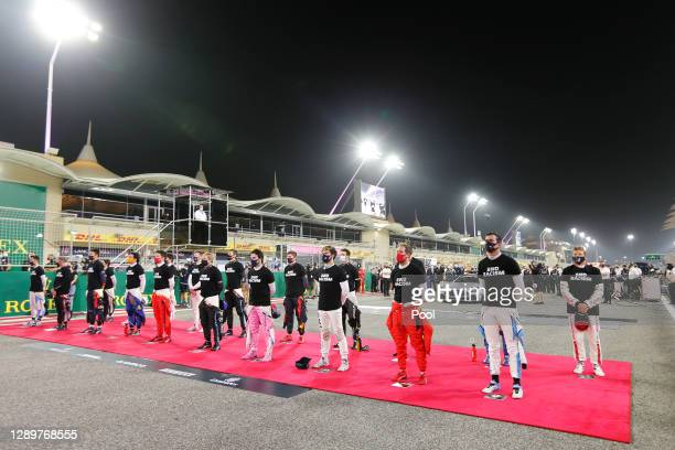 The F1 drivers stand for the national anthem on the grid prior to the F1 Grand Prix of Sakhir at Bahrain International Circuit on December 06, 2020...