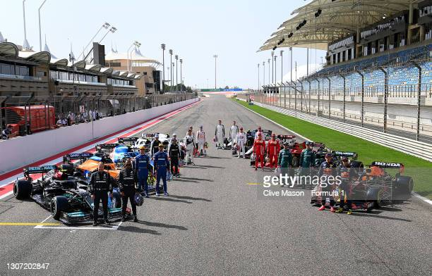 The F1 drivers stand on the grid during Day One of F1 Testing at Bahrain International Circuit on March 12, 2021 in Bahrain, Bahrain.