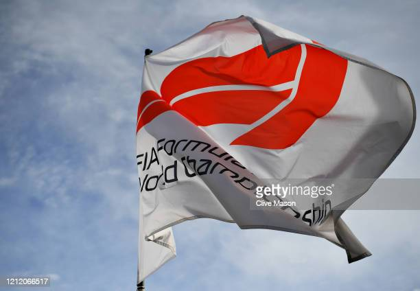 The F1 flag is pictured flying over the circuit before practice for the F1 Grand Prix of Australia at Melbourne Grand Prix Circuit on March 13 2020...