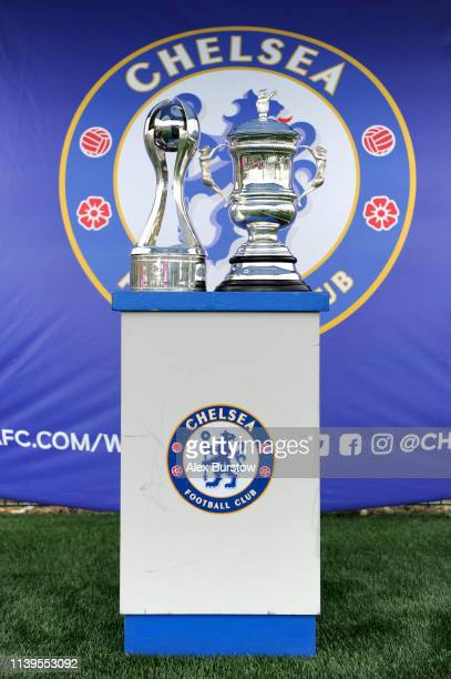 The FA Women's Super League trophy and the Women's FA Cup Trophy are seen on display at the Vitality Football Festival outside the stadium prior to...