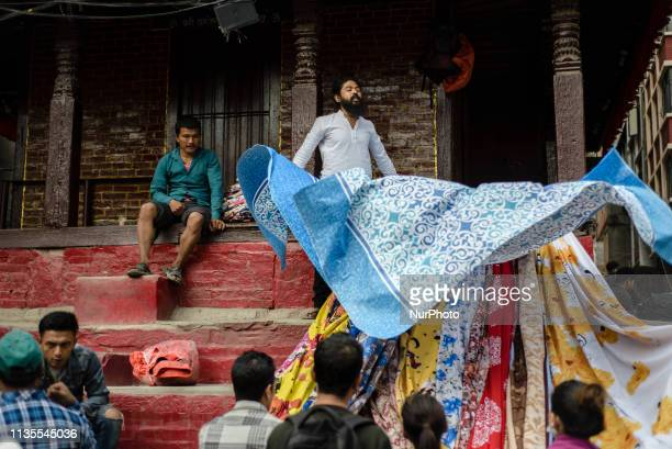 The fabric vendor shows his goods in Thamel district Kathmandu Nepal on April 7 2019