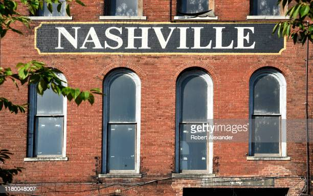 The facade of a 19th century brick warehouse along the Cumberland River in downtown Nashville Tennessee