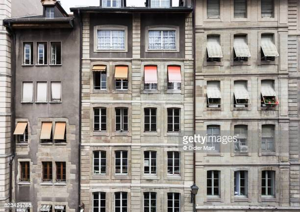 the facade of geneva old town in switzerland - wall building feature stock pictures, royalty-free photos & images