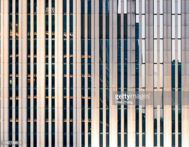 the facade of modern architecture at night - wall building feature stock pictures, royalty-free photos & images