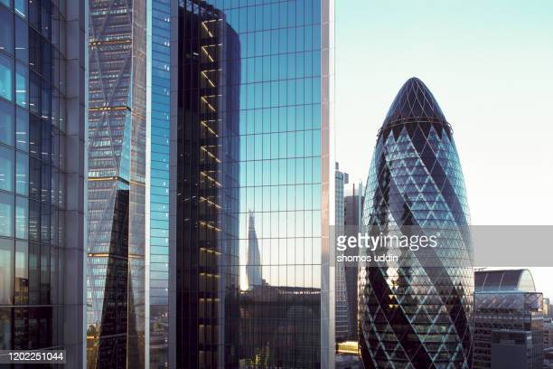 the facade of office windows and skyscrapers - skyscraper stock pictures, royalty-free photos & images