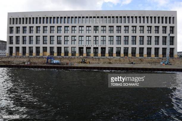 The facade of the Berlin Palace under reconstruction is pictured in Berlin on March 27 2018 The new building of the Berlin Palace located in former...