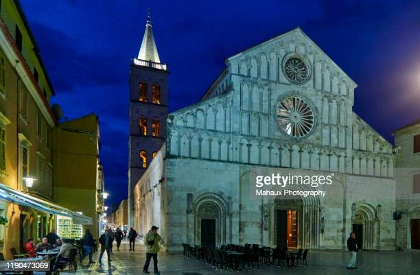 the facade of the catedral of st anastasia  and its bell tower illuminated in zadar - limestone pavement stock pictures, royalty-free photos & images