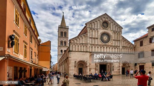 the facade of the catedral of st anastasia  and its bell tower in zadar - limestone pavement stock pictures, royalty-free photos & images