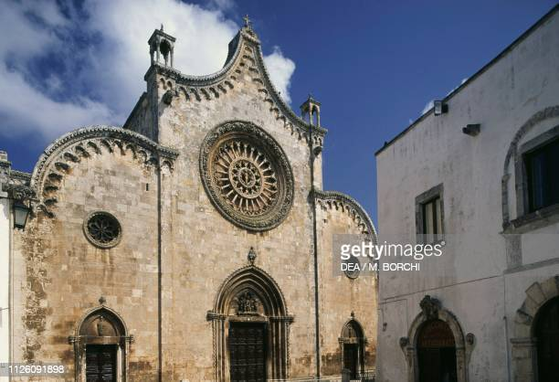 The facade of the Cocathedral with a 24mullion central rose window Ostuni Apulia Italy 15th century