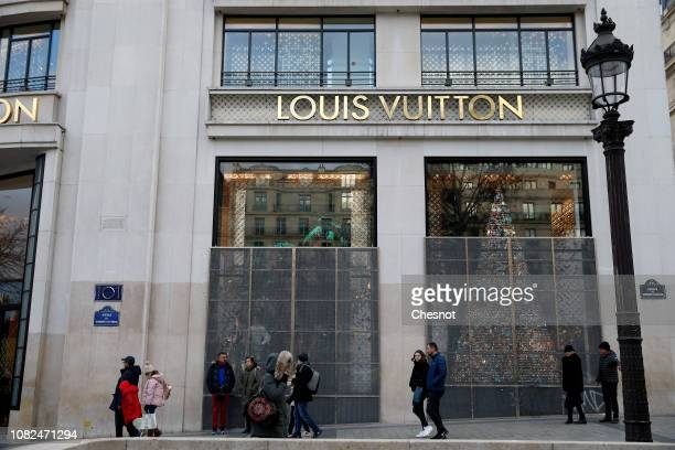 The facade of the Louis Vuitton boutique is covered with metal grilles to protect its against possible damage on the eve of a demonstration of...