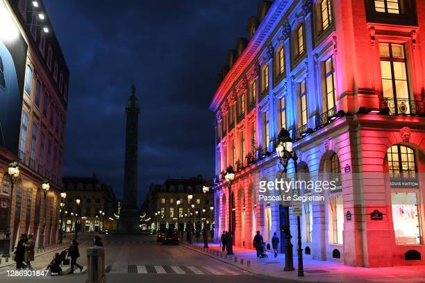The facade of the Louis Vuitton store on Place Vendome is illuminated for Christmas and New Year celebrations on November 21, 2020 in Paris, France.