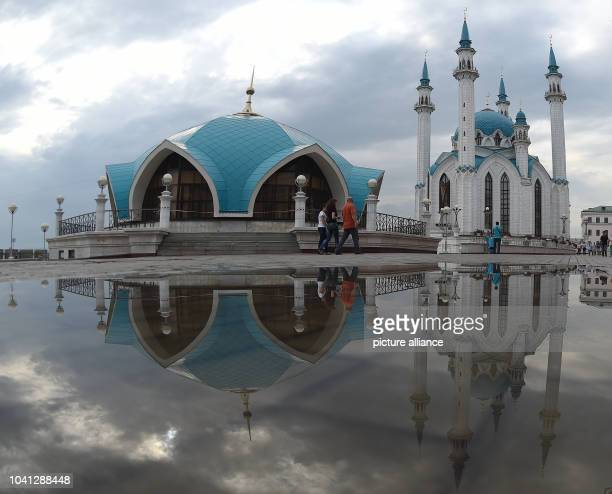 The facade of the Qol Sharif mosque mirrors in a puddle in the city of Kazan Russia 11 July 2015 Photo Marcus Brandt/dpa | usage worldwide