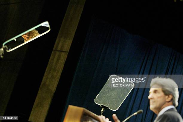The face of an attendee is reflected on a teleprompter screen as Democratic presidential candidate John Kerry delivers a speech at California State...