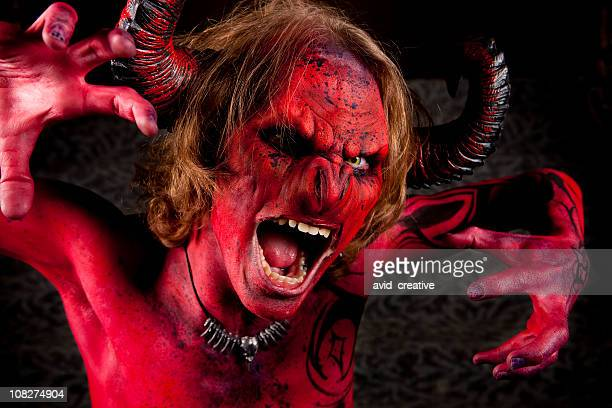the face of evil - devil stock pictures, royalty-free photos & images