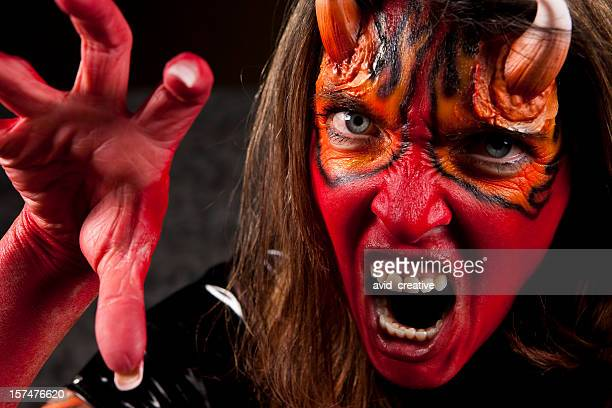 the face of evil-female devil - ugly black women stock photos and pictures