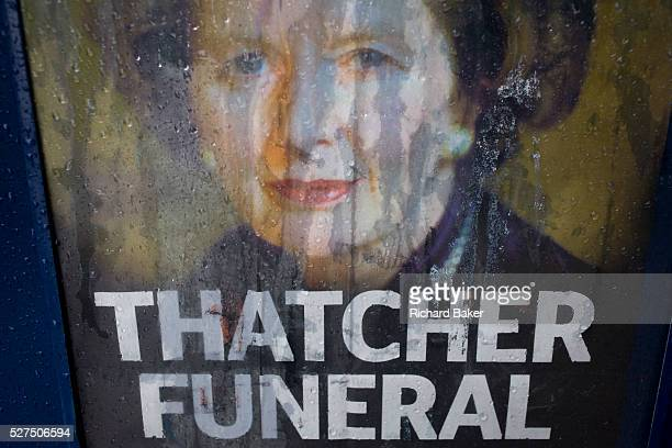 The face of exBritish Prime Minister Margaret Thatcher printed on a newspaper souvenir issue is rain streaked the day after her ceremonial funeral...