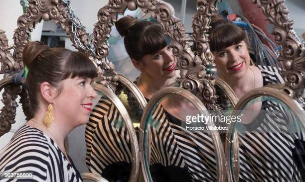 The face of Portuguese artist Joana Vasconcelos is reflected on I'm Your Mirror centerpiece of her solo exhibition I'm Your Mirror at the Guggenheim...