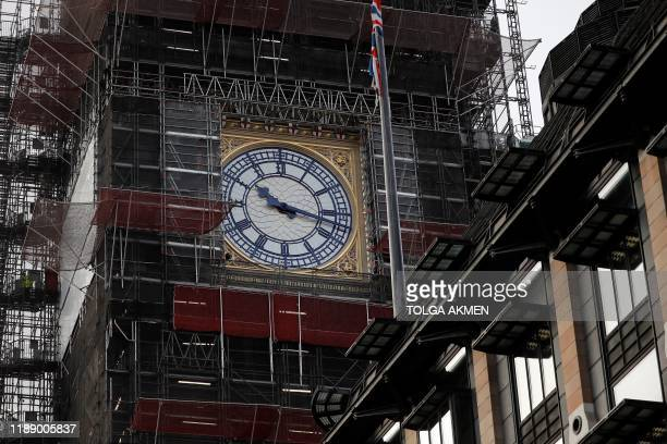 TOPSHOT The face of the clock in the Elizabeth Tower better known as Big is pictured during restoration works at the Houses of Parliament in central...
