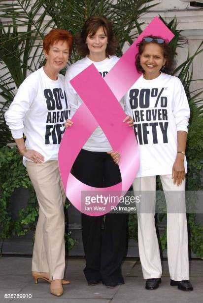 The face of the new 'Boots Be Up Front Campaign' Netta Wooles Cherie Blair and Yvonne Rayan who has had breast cancer four times pose with a pink...