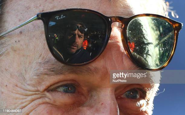 The face of the Parma Sport Director Daniele Faggiano reflected in the sunglasses of the Cagliari's owner Massimo Cellino during the football Serie A...