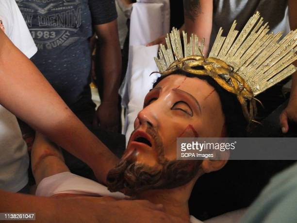 The face of the suffering Christ replica seen during Good Friday Every Good Friday the Malabon City town folks especially the men join a procession...
