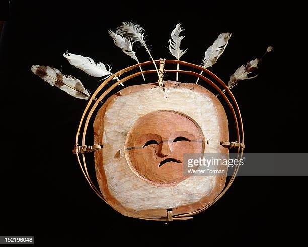 The face on this mask represents the spirit of the moon The board around the face symbolizes air the hoops signify the levels of the cosmos and the...