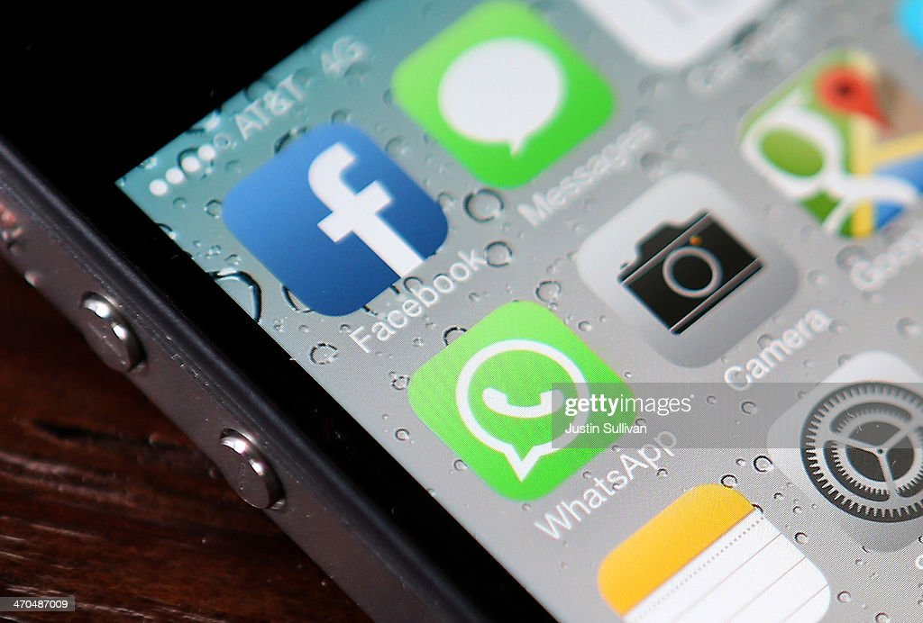 The Facebook and WhatsApp app icons are displayed on an iPhone on February 19, 2014 in San Francisco City. Facebook Inc. announced that it will purchase smartphone-messaging app company WhatsApp Inc. for $19 billion in cash and stock.