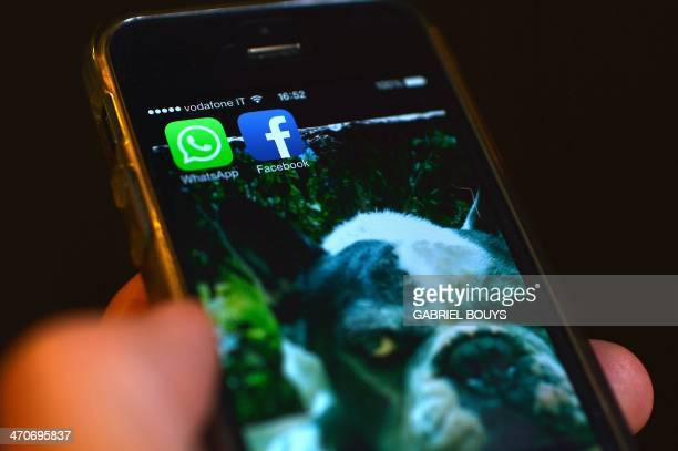 The Facebook and WhatsApp applications' icons are displayed on a smartphone on February 20 2014 in Rome The deal unveiled the day before worth up to...
