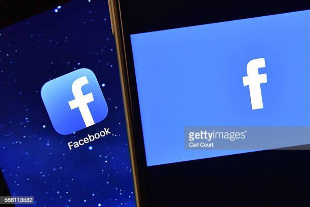 The Facebook app logo is displayed on an iPad next to a picture of the Facebook logo on an iPhone on August 3 2016 in London England