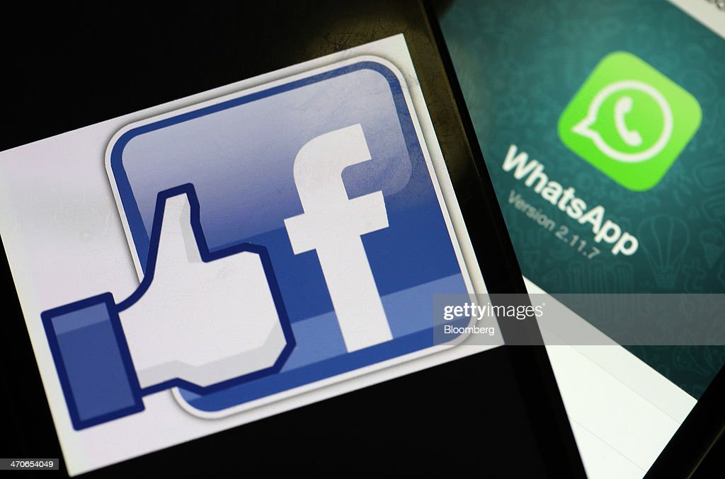 The Facebook Inc. logo for 'like' and the WhatsApp Inc. mobile-messaging application WhatsApp are displayed on Apple Inc. iPhones in this arranged photograph taken in London, U.K., on Thursday, Feb. 20, 2014. Facebook, the worlds largest social network, agreed to acquire mobile-messaging startup WhatsApp Inc. for as much as $19 billion in cash and stock, seeking to expand its reach among users on mobile devices. Photographer: Chris Ratcliffe/Bloomberg via Getty Images