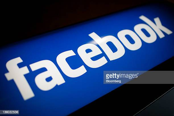 The Facebook Inc logo is displayed at the company's office in New York US on Tuesday Dec 20 2011 'Cool spaces' will spread to US cities outside major...