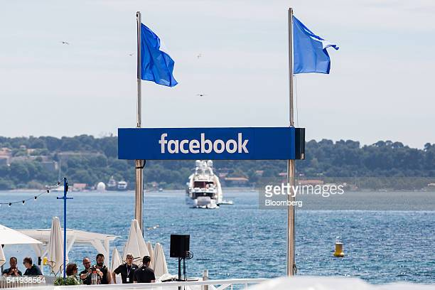 The Facebook Inc logo sits on a sign beside the harbour during the Cannes Festival of Creativity in Cannes France on Tuesday June 21 2016 Burberry...