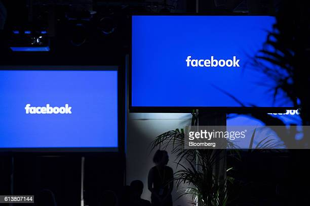 The Facebook Inc logo sits on screens ahead of the global launch event of 'Workplace' at the Facebook Inc offices in London UK on Monday Oct 10 2016...