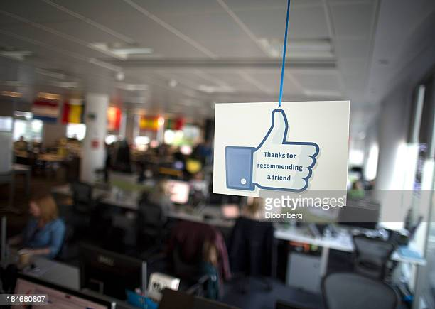 The Facebook 'Like' symbol is seen hanging from the ceiling inside the offices of Facebook Inc's European headquarters at Hanover Quay in Dublin...