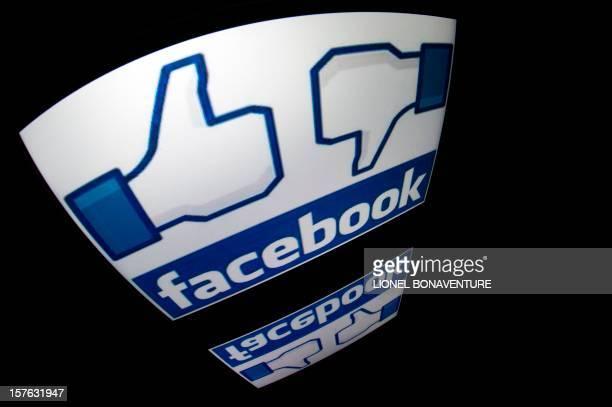 The 'Facebook' logo is seen on a tablet screen on December 4 2012 in Paris AFP PHOTO / LIONEL BONAVENTURE