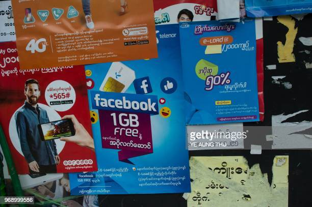 The Facebook logo is seen on an advertisement by a local telecom company in Yangon on June 7 2018 Facebook has blacklisted a group of Myanmar...