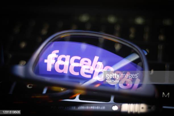 The Facebook logo is seen reflected in a pair of glasses on a computer keyboard in this photo illustration in Warsaw, Poland on March 4, 2021. As...