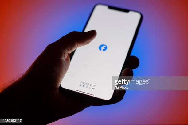 The Facebook social media application is seen on an iPhone in this photo illustration in Warsaw, Poland on December 17, 2020. Facebook has disabled...