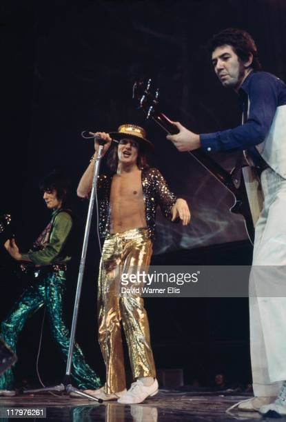 guitarist Ronnie Wood singer Rod Stewart and bassist Ronnie Lane British rock band on stage during a live concert performance circa 1973