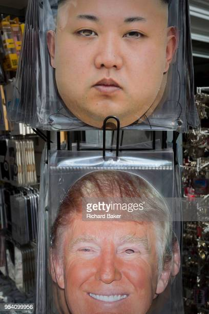 The faces of a serious North Korean leader Kim Jongun and a smiling US President Donald Trump appear on face masks outside a tourist trinket retailer...
