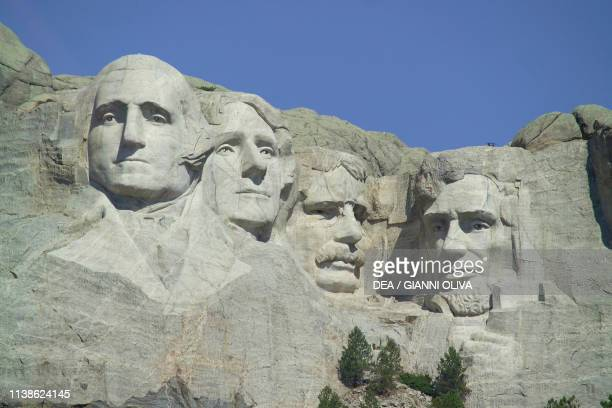 The faces of American Presidents George Washington Thomas Jefferson Theodore Roosevelt and Abraham Lincoln carved in the granite Mount Rushmore...