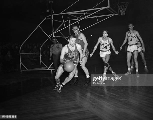 The faces of Don Carlson of the Chicago stags and the unidentified teamate behind him reflect the momentary good fortune of their team as Carlson...