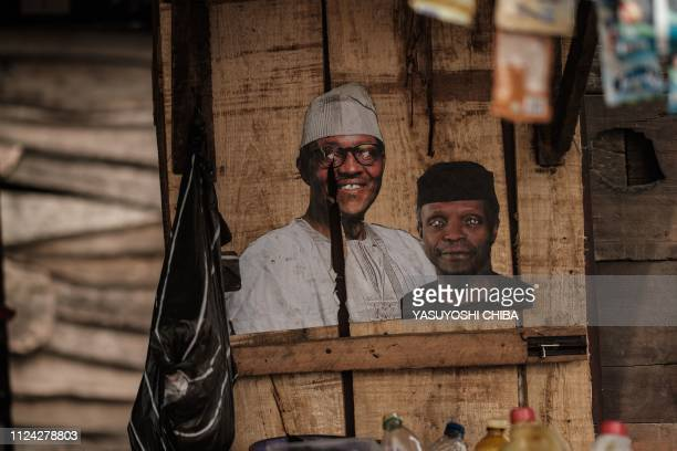 The faces of Nigeria's incumbent President Mohammadu Buhari and Vice President Yemi Osinbajo are seen at a kiosk in Lagos Nigeria on February 12 2019...